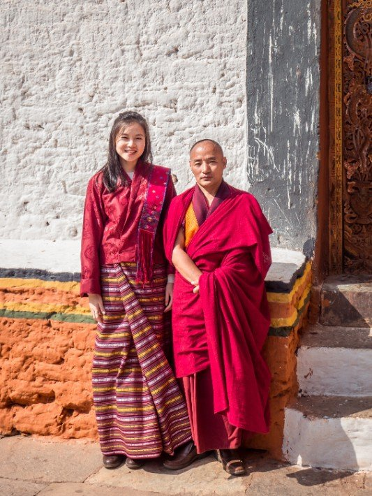 Punakha-Dzong-traditional-costume-red-robed-monk